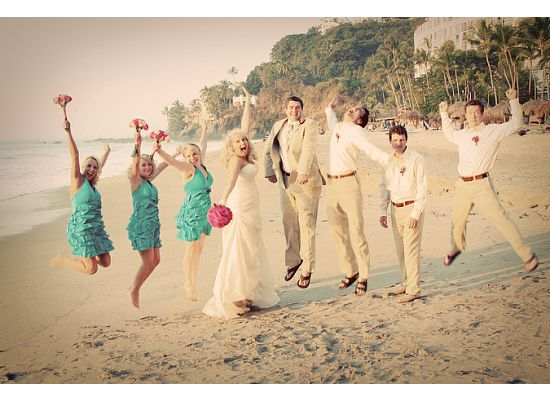 beach bride and groom with groomsmen and bridesmaids