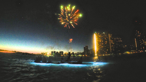 Stand-Up Paddleboarding with Fireworks