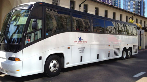 Shared Shuttle: Roundtrip SeaWorld® Transfer by Five Star San Diego