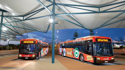 Shared Shuttle: Return Theme Park Transfer by Gold Coast Tourist Shuttle